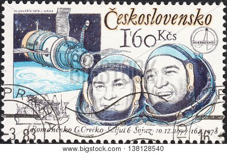 MOSCOW RUSSIA - DECEMBER 2015: a post stamp printed in CZECHOSLOVAKIA shows shows astronauts Yuri Romanenko and Georgiy Grechko circa 1978
