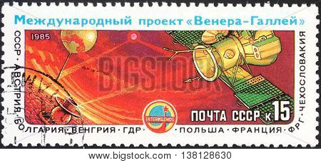 MOSCOW RUSSIA - DECEMBER 2015: a post stamp printed in the USSR shows space equipment devoted to the International Venus-Halley's Comet Space Project circa 1985
