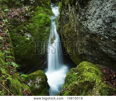 Waterfall movement on the stone background