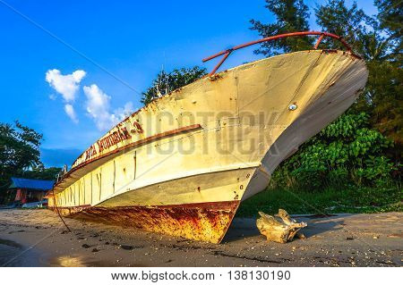 Labuan,Malaysia-July 12,2016:Abandoned of ferry known as Duta Muhibbah Tiga in Nagalang tropical beach at Labuan island on 12th July 2016.