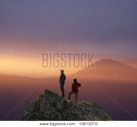 Men and women overview sunset landscape