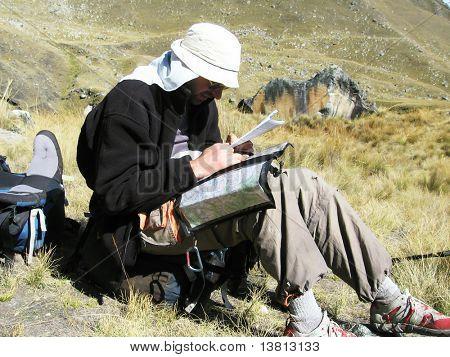male looling maps in Cordilleras mountain