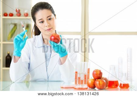 Science Researcher Holding Up A Gmo Plant