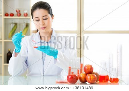 Asian Female Scientist Examining For Genetic Modification Food