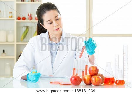Asian Female Scientist Try To Find The Answer For Gmo Food