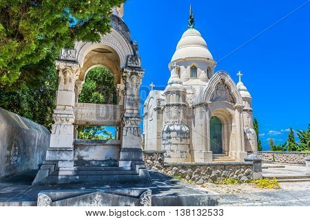 Old cemetery in town Supetar, Island of Brac, view at entrance building exterior made with traditional architecture style.