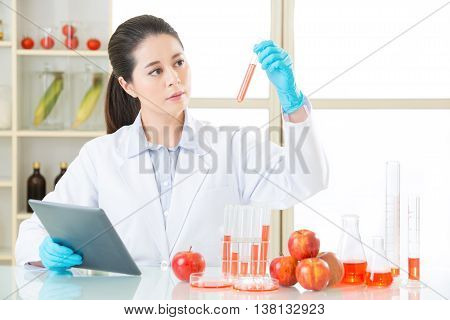 Looking At Lab Tube And Find The Answer For Gmo Food