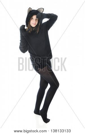 A beautiful teen girl dancing in a black cat outfit.  On a white background.