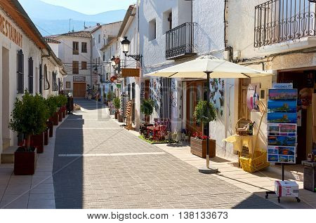 Guadalest Spain- February 2 2016: Charming narrow street with souvenir shops of a Guadalest. Guadalest is a small village on the Costa Blanca the most visited village in Spain