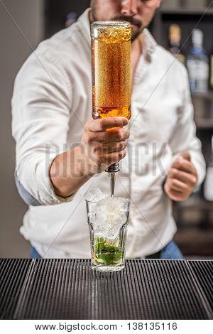 Barman at work preparing mojito cocktail, bartender
