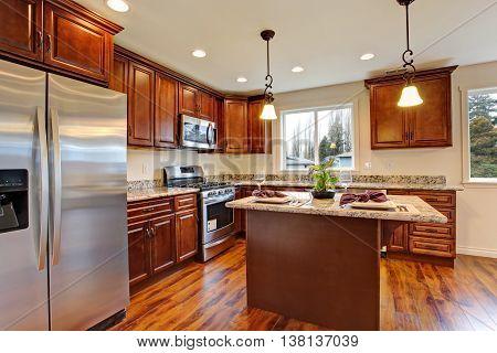 Kitchen With Hardwood Floor And Granite Counter Tops.