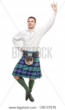 Scottish man in traditional national costume isolated