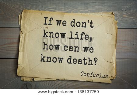 Ancient chinese philosopher Confucius quote on old paper background. If we don't know life, how can we know death?