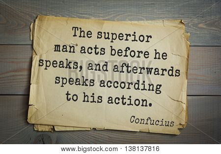Ancient chinese philosopher Confucius quote on old paper background. The superior man acts before he speaks, and afterwards speaks according to his action.