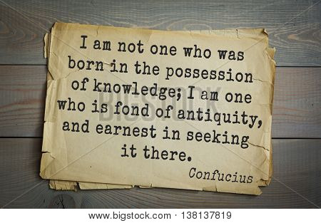 Ancient chinese philosopher Confucius quote on old paper background. I am not one who was born in the possession of knowledge; I am one who is fond of antiquity, and earnest in seeking it there.