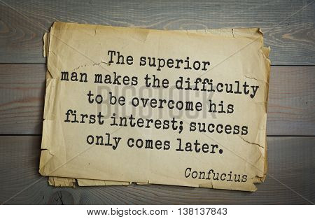 Ancient chinese philosopher Confucius quote on old paper background. The superior man understands what is right; the inferior man understands what will sell.