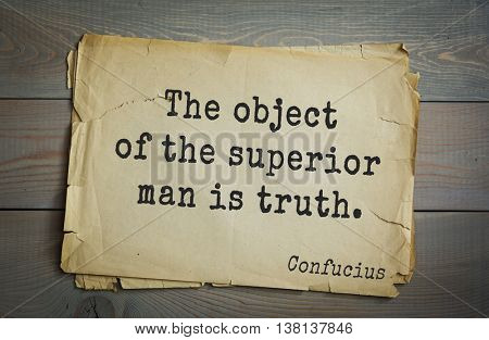 Ancient chinese philosopher Confucius quote on old paper background. The object of the superior man is truth.