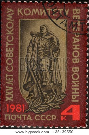 MOSCOW RUSSIA - DECEMBER 2015: a post stamp printed in the USSR shows a monument in the Treptow Park Berlin devoted to the 25th Anniversary of Soviet War Veterans Committee circa 1981