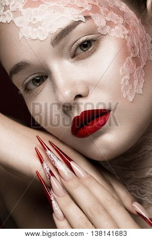 Beautiful girl with lace, red lips and long nails. Beauty face. Photos shot in studio