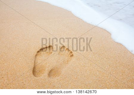 beach, wave and footprints