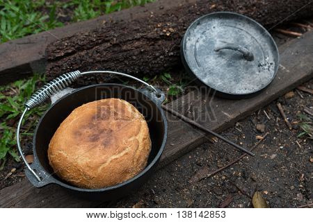 Damper bread cooked in camp oven on coals