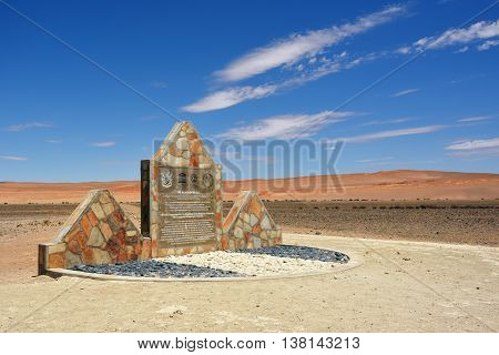 NAMIBIA - JAN 29 2016: The memorial sign placed in front of the entrance to the Namib Naukluft National Park in the memory of its recognition as World Heritage site