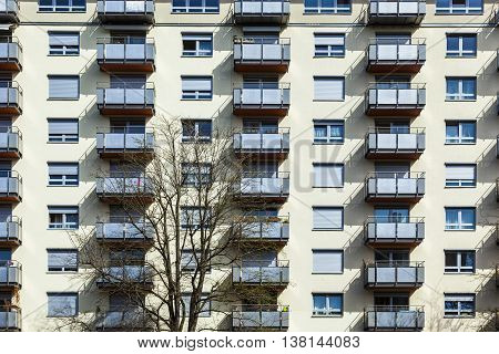 generic house facade with many balconies in row