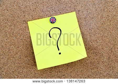 Yellow Paper Note Pinned With Great Britain Flag Thumbtack And Question Mark