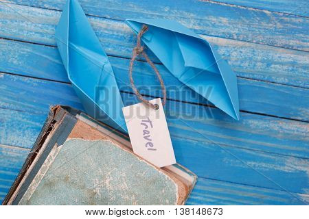 Paper Boat With A Sign Travel With Vintage Book - Travel Concept