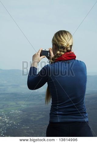 Young photographer in the mountain