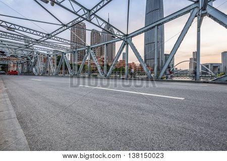motion blurred traffic at steel bridge