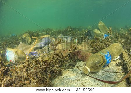 Plastic water bottles and bags pollution on sea floor