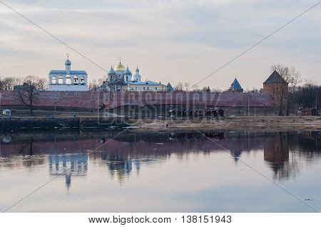 Architecture spring panoramic landscape view of Novgorod Kremlin fortress and St Sophia cathedral on the bank of the Volkhov river in spring sunset evening
