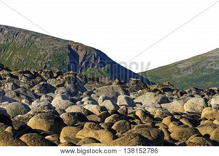 Round stones on a background of mountains, the ocean, Norway, Scandinavia, Travel isolated on white