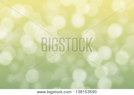 Abstract circular green and soft yellow light bokeh background