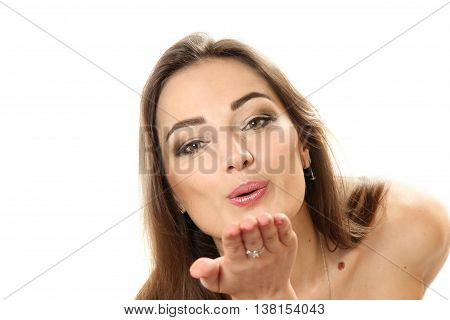 air-kiss - a horizontal portrait of the young woman on a white background