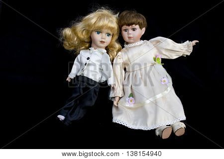Girl and Boy Doll broken wedding body on black background