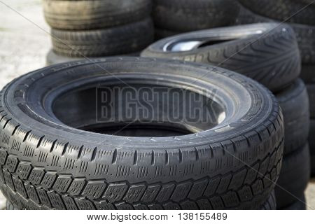 Erased automobile tires background. Structure of a tread of rubber.