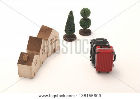 Houses and suitcases on white background. Vacation rentals, renting private homes and rooms.