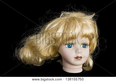 Girl Blonde Doll Head on Black Background