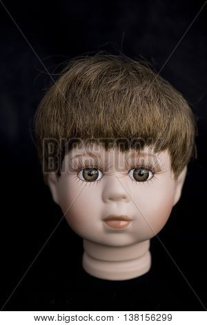 Little Boy Doll Head On Plain Background