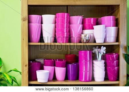new violet flowerpots in a shelf in a market