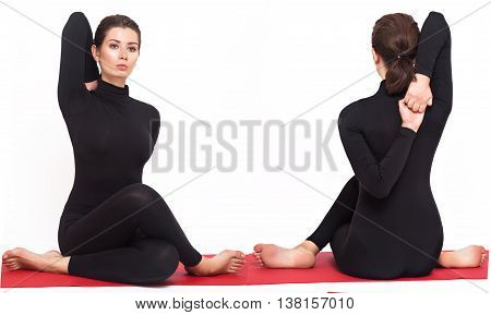 Beautiful athletic girl in a black suit doing yoga. gomukhasana asana - pose cow's head. Isolated on white background.