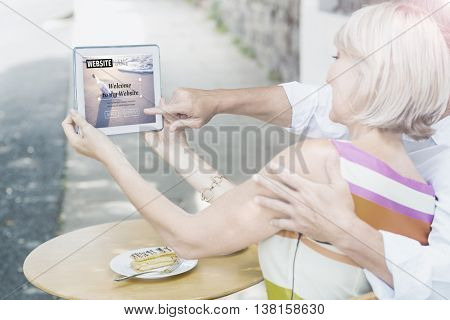 Composite image of build website interface against couple taking a selfie