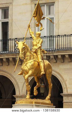 Big golden statue of Joan of Arc on horseback in Paris