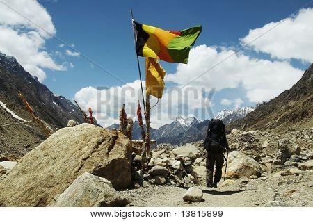 Hiker going along worshipplace by source of Ganga