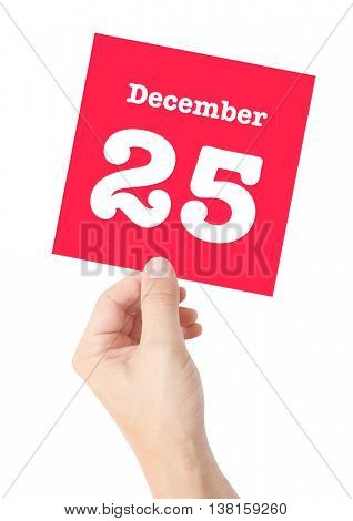 December 25 written on a card held by a hand