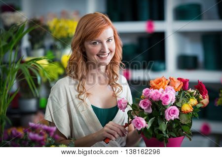 Portrait of female florist preparing flower bouquet in flower shop