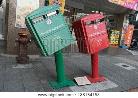 Taipei Taiwan - March 03 2016 : Leaning postboxes at Zhongshan district Taipei. The boxes two of 10986 around Taiwan gained fame after Typhoon Soudelor ripped across the island on August 8 2015