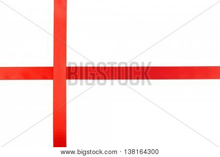 Crossed red ribbons on white background